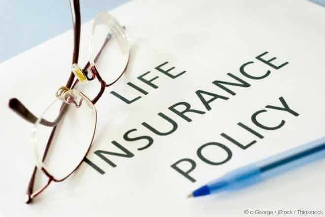 Glasses and Pen on Life Insurance Policy
