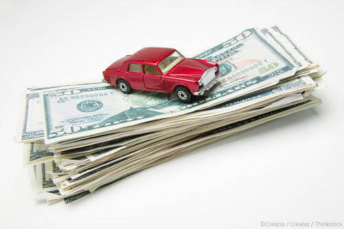 Red Car on Pile of Cash