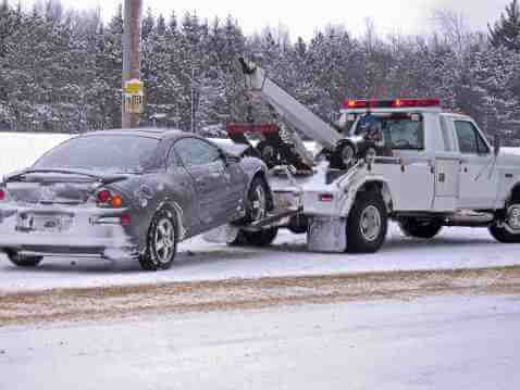 Snowy Car Getting Towed