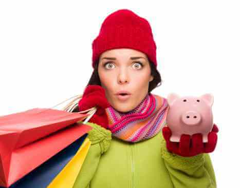 Woman with gift bags and piggy bank