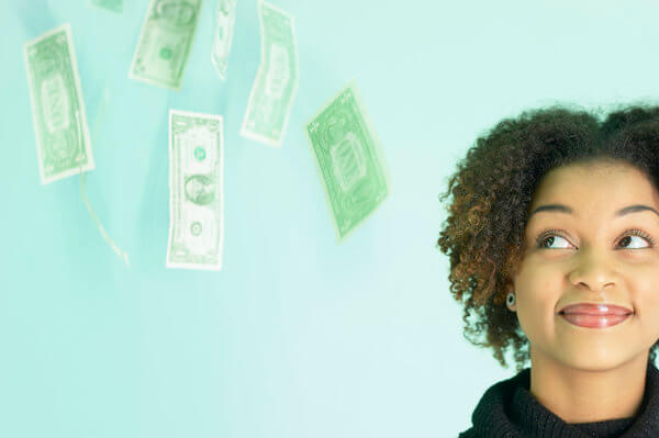 african american girl with cash floating near her head