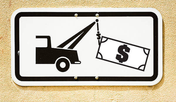 Tow truck towing dollar bill