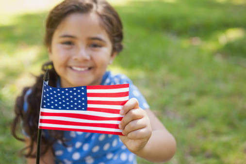 Patriotic Little Girl with American Flag