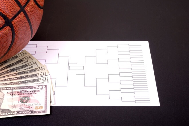 March Madness Bracket Basketball and Fanned Money on Black