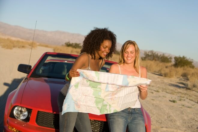 Women Looking at Road Map