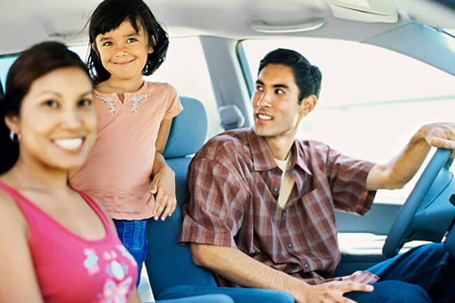 What You Need to Know About Policy Renewals - Happy Family in Car