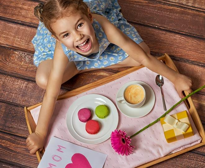 girl with Mother's Day breakfast
