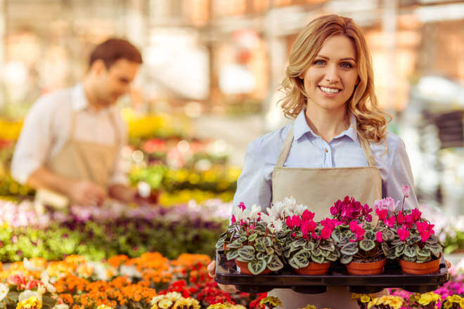 Small Business Owner Holding Flowers
