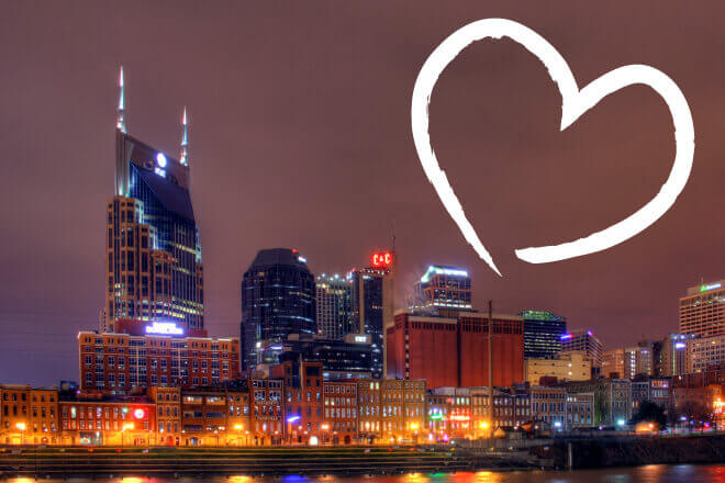 Nashville skyline at night with white, hand-drawn heart in the upper right hand corner