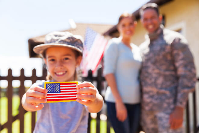 Little girl proudly shows off her American flag patch