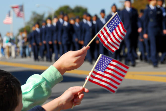 children-wave-flags-in-veterans-day-parade