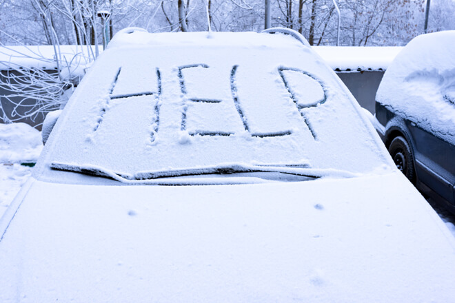 car-stuck-in-snow-asking-for-help