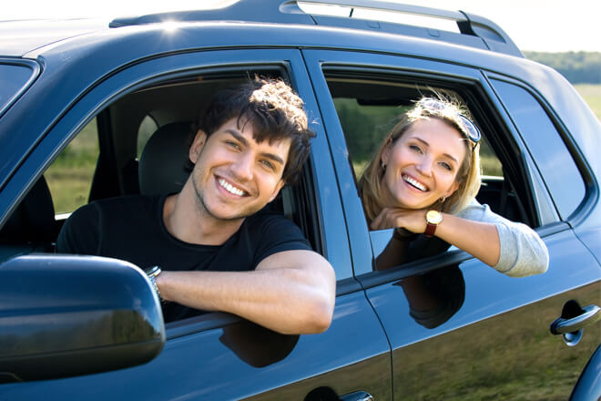 couple-smiles-in-car-windows-down