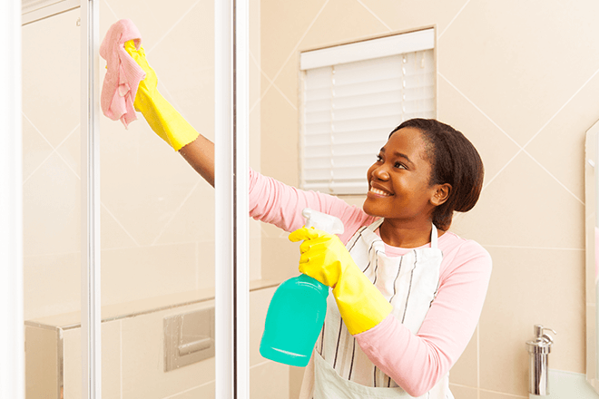 women-smiles-cleaning-her-shower