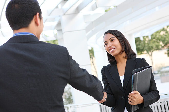 girl-shakes-hand-of-employer-after-interview