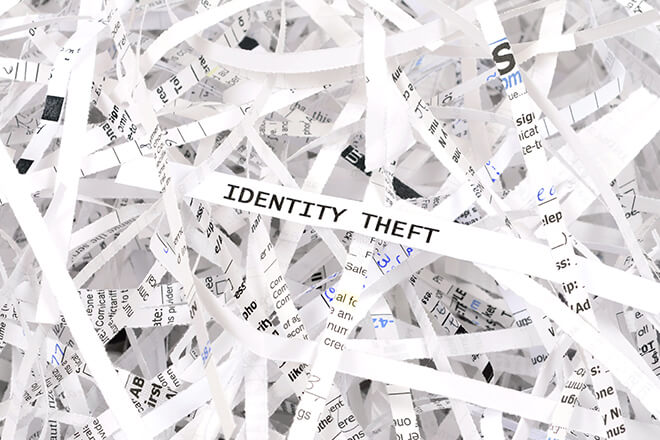 Identity theft printed on shreds of paper