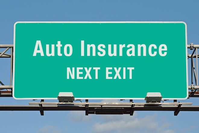 auto insurance next exit road sign