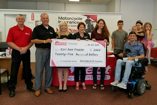 "Winner of the Direct Auto Insurance ""Florida Referral Sweepstakes"" $2,500 Grand Prize receives winnings."