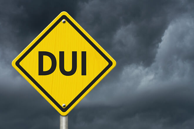 Yellow DUI road sign.