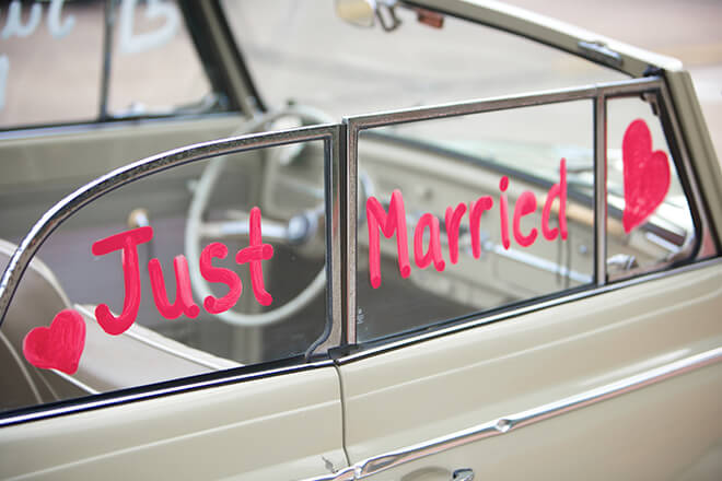 Just married written on car window