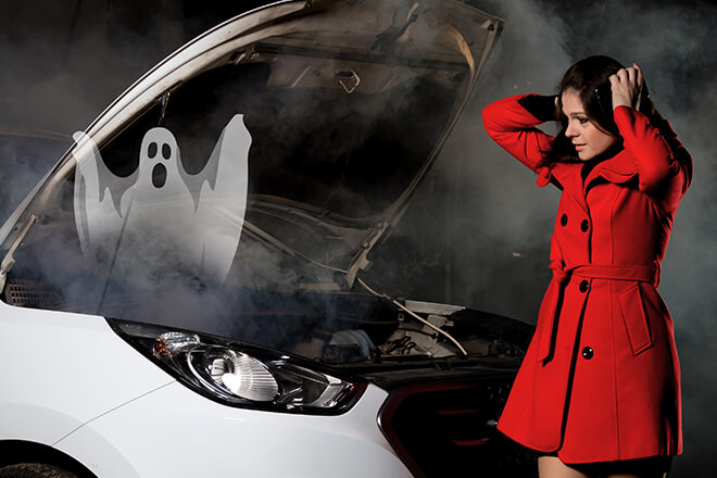 spooky ghost coming from front of car at night with woman in red coat