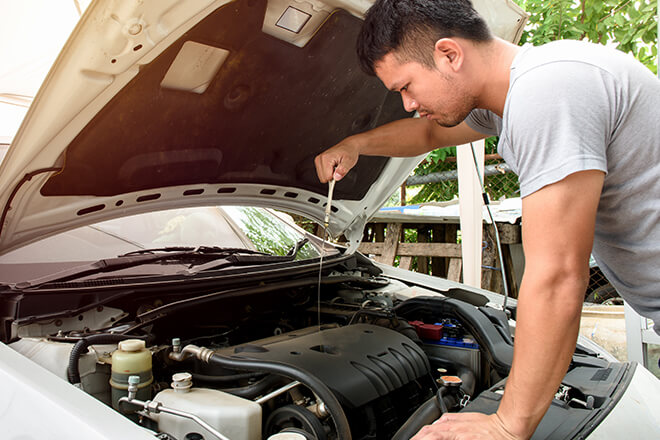 Behind hood of vehicle; car repair assistance programs