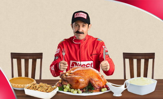 JJ Hightail at Thanksgiving dinner table with Turkey and all the fixings (JJ's Gobbler Giveaway from Direct Auto & Life Insurance)