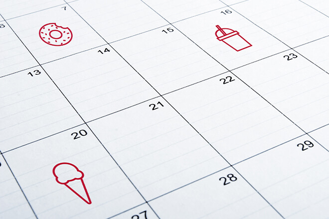 Calendar with food graphics to mark free food days.