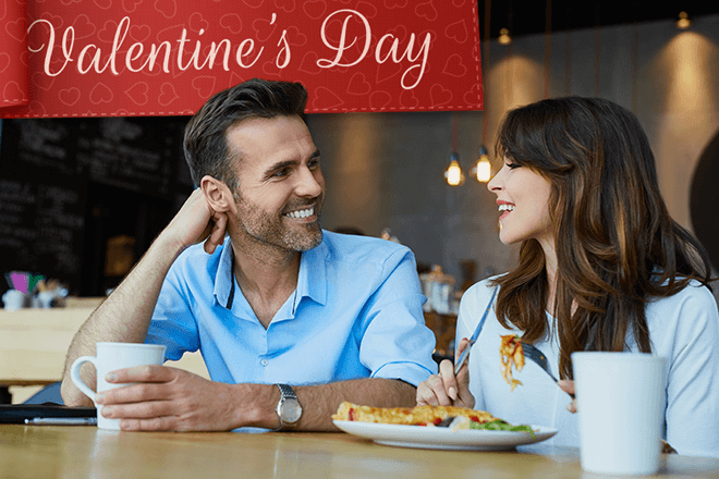 Couple spending Valentine's Day together eating out.