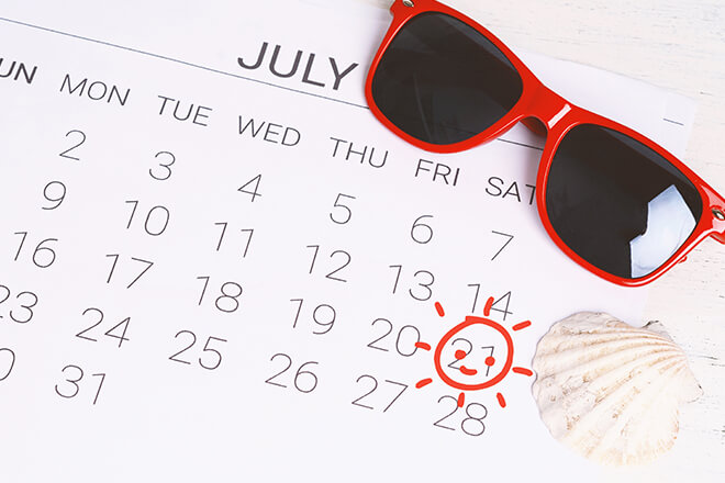 Red sunglasses on July Calendar