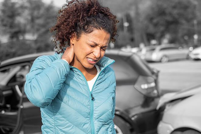 Woman touching hurt neck after car accident.