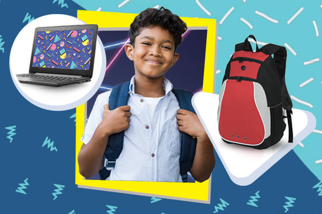 Child smiling with a backpack on. Chromebook laptop to the left, red backpack to the right.