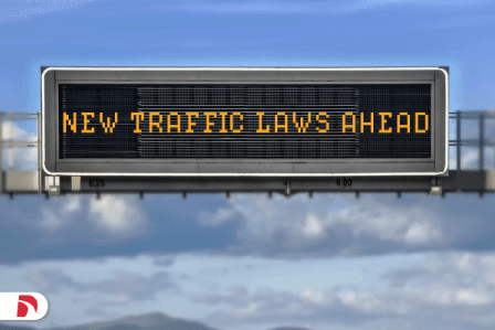 New traffic laws ahead road sign