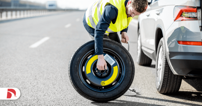 roadside assistance worker with tire