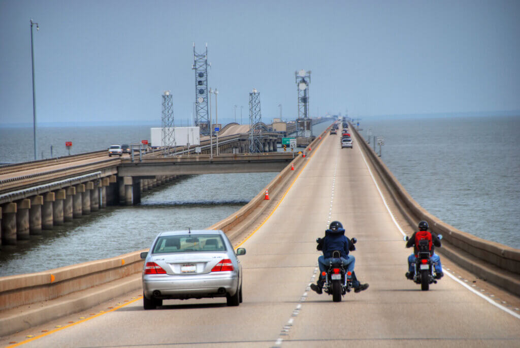 Car and motorcycles driving down Lake Pontchartrain Causeway