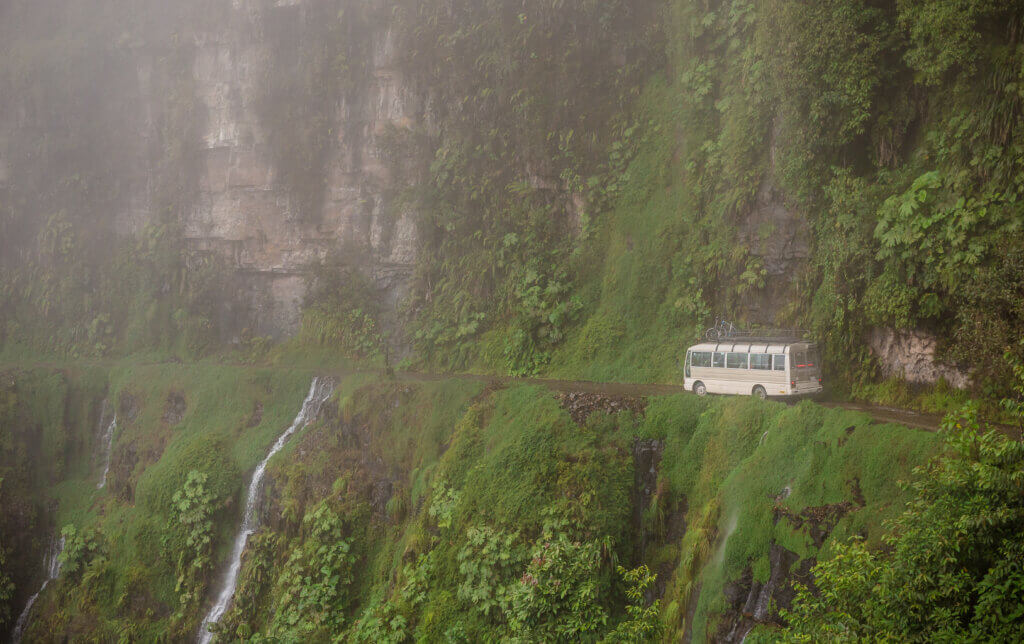 bus navigating dangerous stretch of yungas road
