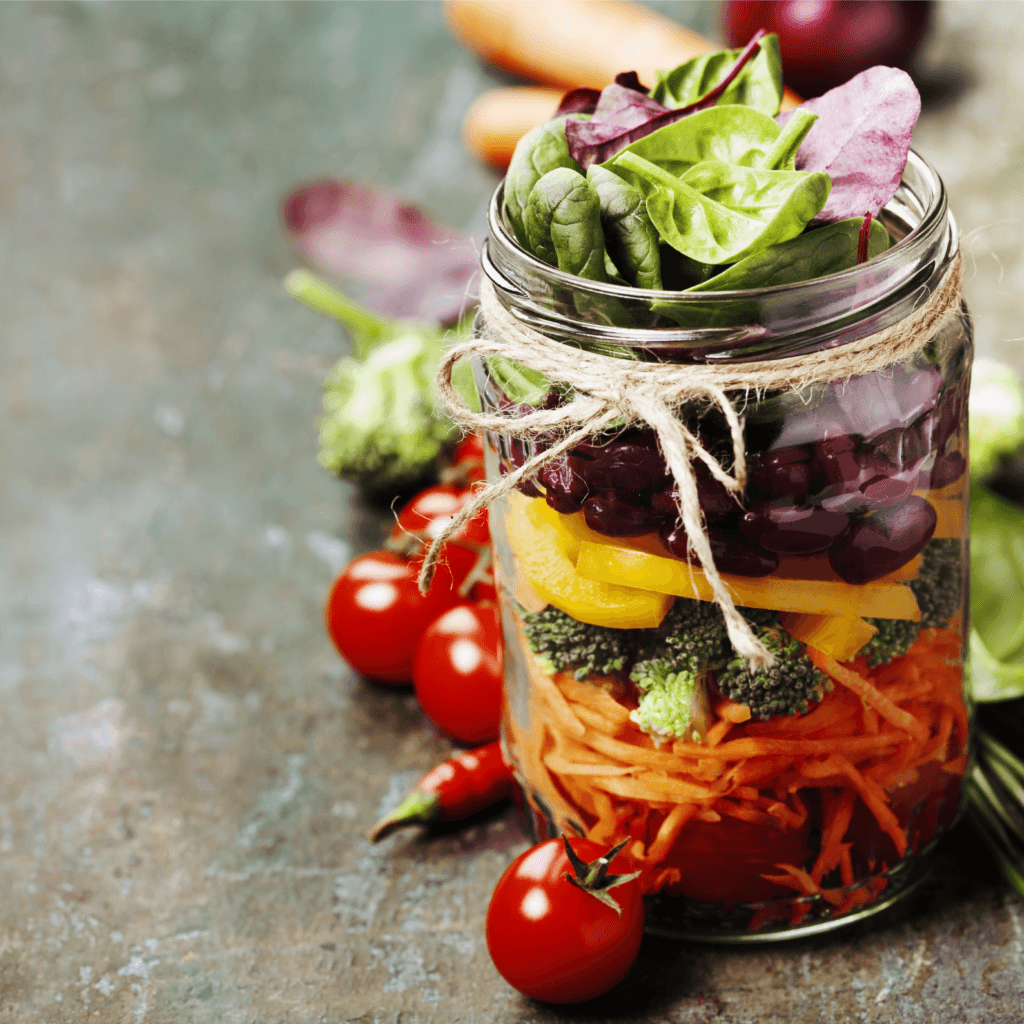 Fall mason jar salad with butternut squash and maple cider vinaigrette