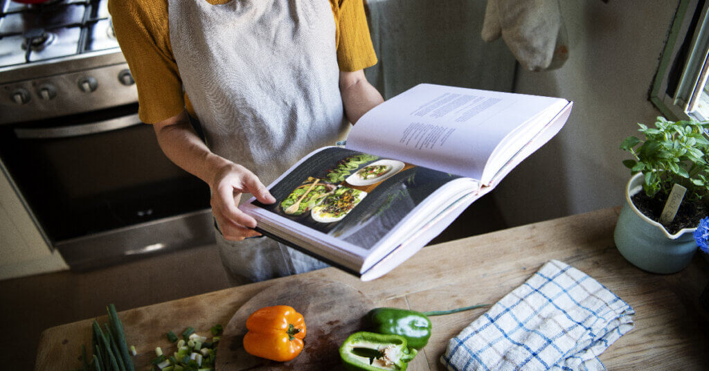 a person flipping through a cookbook