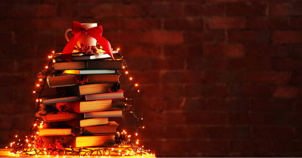 a christmas tree of sorts constructed with books