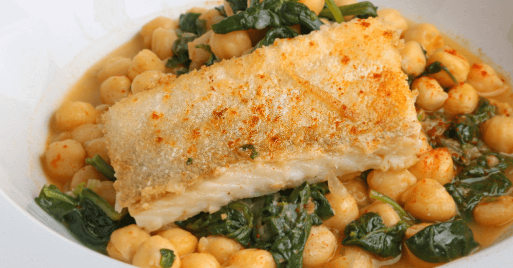 Whitefish filet served over savory broth with greens and spiced chickpeas
