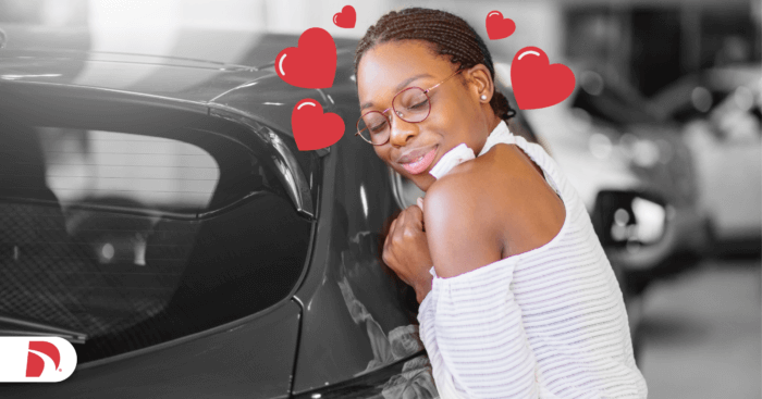 a woman leans against her new car