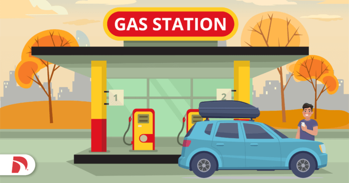 car on a road trip in front of gas station.